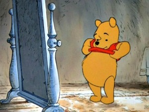 Winnie-the-Pooh looking at his stomach